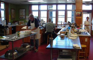 Students at work in the cooking studio.